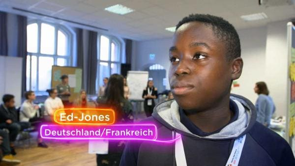 "Ed-Jones in einem Konferenzraum auf der ""Youth for Peace"". 